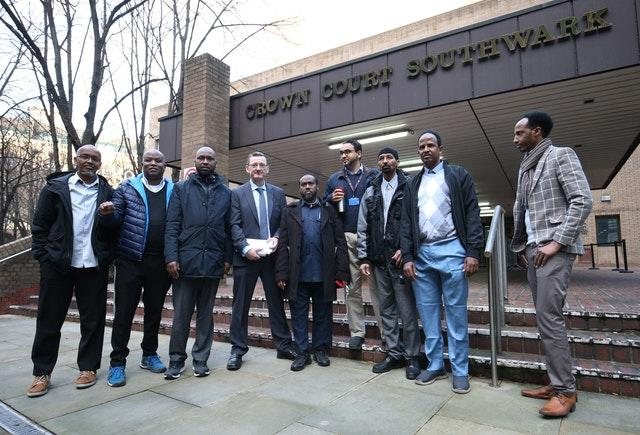 James Farrar, fourth left, with Uber drivers outside Southwark Crown Court