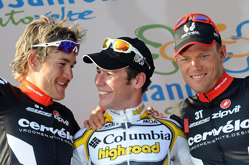 Columbia-Highroad's Mark Cavendish tries to console second-placed Heinrich Haussler on the podium of the 2009 Milan-San Remo, with Haussler's Cervélo TestTeam teammate Thor Hushovd having taken third