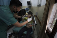 A medic treats a wounded boy following an explosion in the town of Beit Lahiya, northern Gaza Strip, on Monday, May 10, 2021, during a conflict between Hamas and Israel. (AP Photo/Mohammed Ali)