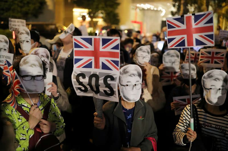 Protesters attend a rally outside the British Consulate General in Hong Kong