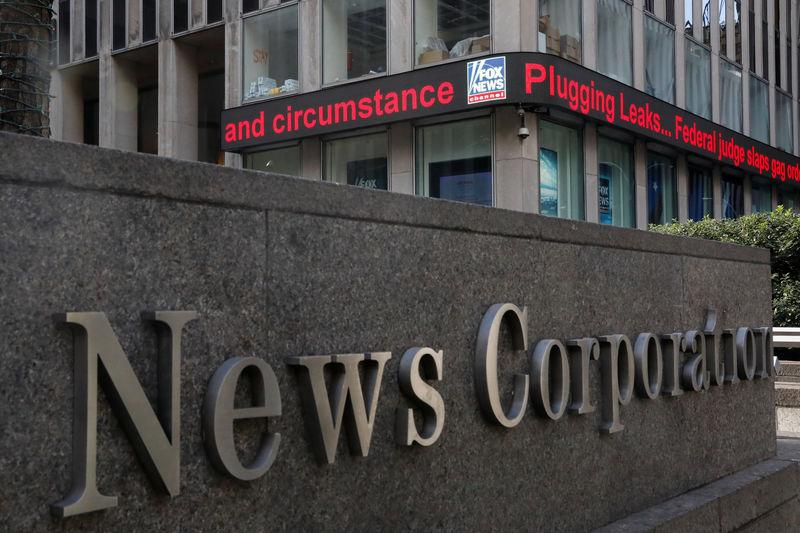 The Fox News electronic ticker is seen outside the News Corporation building in New York City