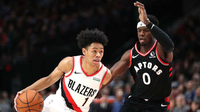 PORTLAND, OREGON - NOVEMBER 13: Anfernee Simons #1 of the Portland Trail Blazers drives against Terence Davis #0 of the Toronto Raptors in the fourth quarter at Moda Center on November 13, 2019 in Portland, Oregon. NOTE TO USER: User expressly acknowledges and agrees that, by downloading and or using this photograph, User is consenting to the terms and conditions of the Getty Images License Agreement (Photo by Abbie Parr/Getty Images) (Photo by Abbie Parr/Getty Images)