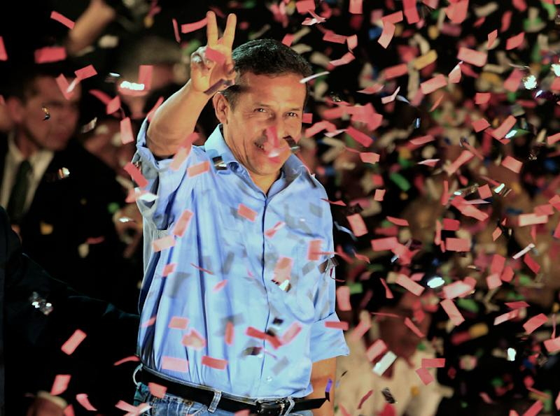 Presidential candidate Ollanta Humala flashes a victory sign to supporters after the presidential runoff election in Lima, Peru, Sunday June 5, 2011. The 48-year-old narrowly won Peru's presidency in a bitterly fought runoff with the daughter of disgraced ex-President Alberto Fujimori. (AP Photo/Martin Mejia)