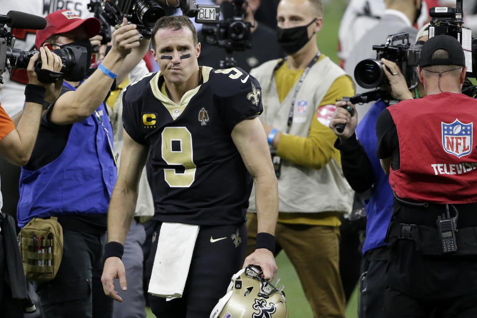 New Orleans Saints quarterback Drew Brees (9) leaves the field after Sunday's loss to the Buccaneers. (AP Photo/Butch Dill)