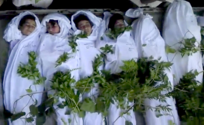 This image made from video and released by Shaam News Network and accessed Thursday, Aug. 23, 2012, purports to show the funeral of children in Daraya, near Damascus, Syria. Syrian troops backed by tanks and helicopters broke into a Damascus suburb on Thursday following two days of shelling and intense clashes as part of a widening offensive by President Bashar Assad's forces to seize control of parts of the capital and surrounding areas from rebel fighters, activists said. At least 15 people were killed in the offensive on Daraya, only a few miles (kilometers) southwest of Damascus. (AP Photo/Shaam News Network SNN via AP video) THE ASSOCIATED PRESS HAS NO WAY OF INDEPENDENTLY VERIFYING THE CONTENT, LOCATION OR DATE OF THIS PICTURE.