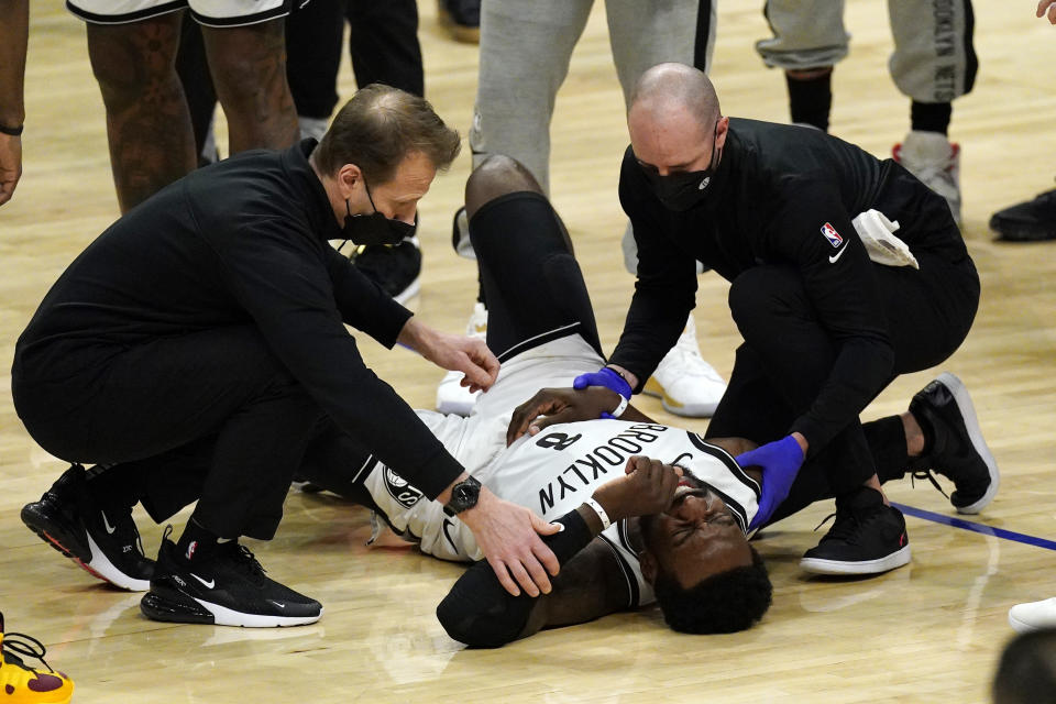 Brooklyn Nets forward Jeff Green is attended to after being injured in a collision with Los Angeles Clippers guard Patrick Beverley during the second half of an NBA basketball game Sunday, Feb. 21, 2021, in Los Angeles. (AP Photo/Mark J. Terrill)