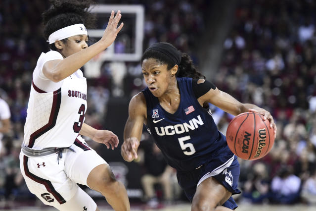 Connecticut guard Crystal Dangerfield (5) dribbles against South Carolina guard Destanni Henderson (3) during the second half of an NCAA college basketball game Monday, Feb. 10, 2020, in Columbia, S.C. South Carolina defeated Connecticut 70-52. (AP Photo/Sean Rayford)