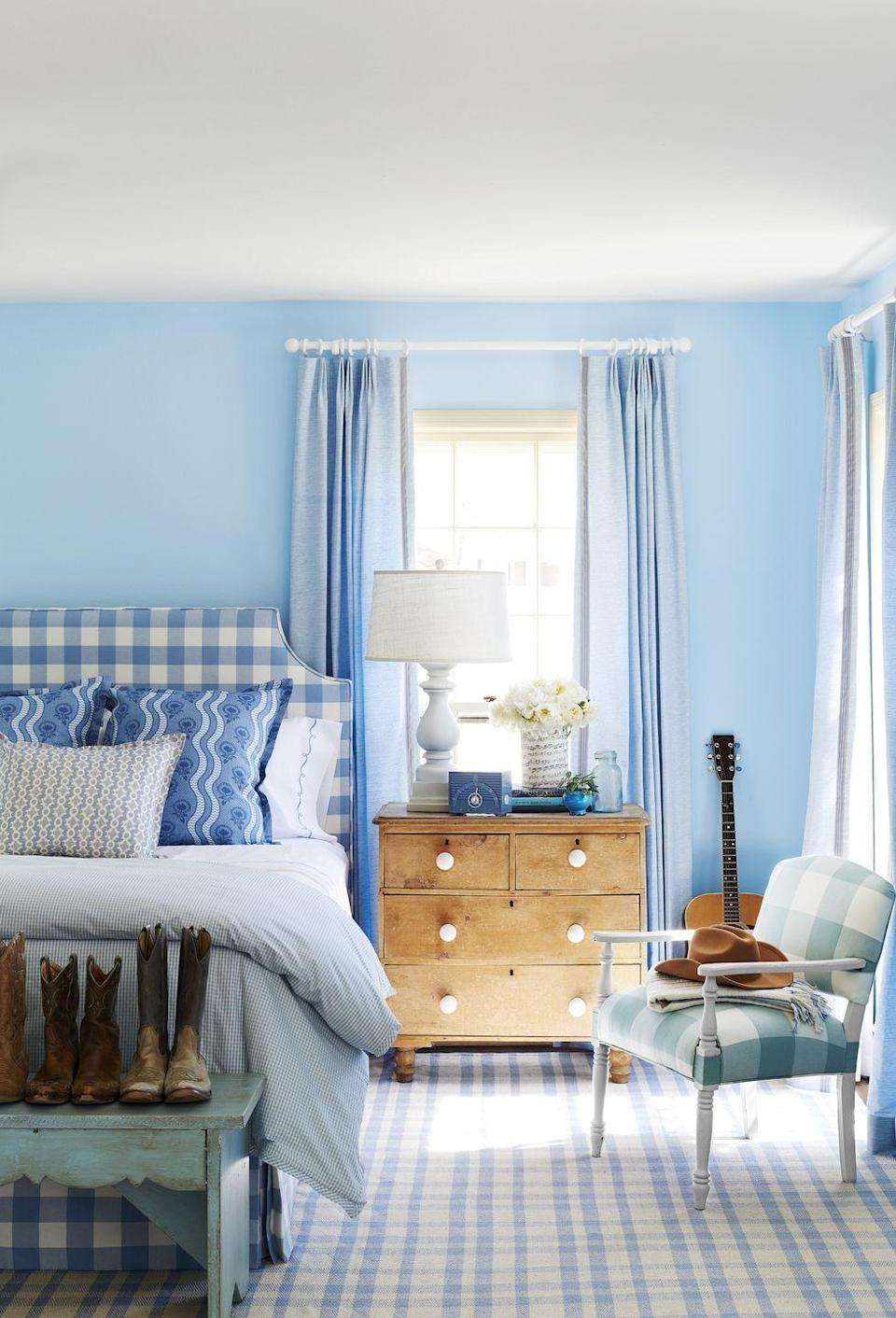 """<p>From chambray-like draperies and a periwinkle-tinged rug to a blueberry-checked headboard and cornflower throw pillows—a major wash of all things blue makes for the perfect bedroom. """"Bright colors boost your mood, so choosing this for a bedroom is a sure way to wake up feeling energized,"""" says EasyCare color expert Cynthia Cornell. """"Try a blue in a bright shade to bring calm and serenity."""" </p><p><strong>Get the Look: </strong><br>Wall Paint Color: <a href=""""https://go.redirectingat.com?id=74968X1596630&url=https%3A%2F%2Fwww.walmart.com%2Fip%2FPRATT-LAMBERT-Z48W00801-16-Interior-Paint-Lake-s-Mirage-Semi-Gloss-1-gal%2F616028059&sref=https%3A%2F%2Fwww.countryliving.com%2Fremodeling-renovation%2Fhome-makeovers%2Fg32468539%2Fbest-bedroom-paint-colors-ideas%2F"""" rel=""""nofollow noopener"""" target=""""_blank"""" data-ylk=""""slk:Lake's Mirage by Pratt & Lambert"""" class=""""link rapid-noclick-resp"""">Lake's Mirage by Pratt & Lambert</a></p>"""