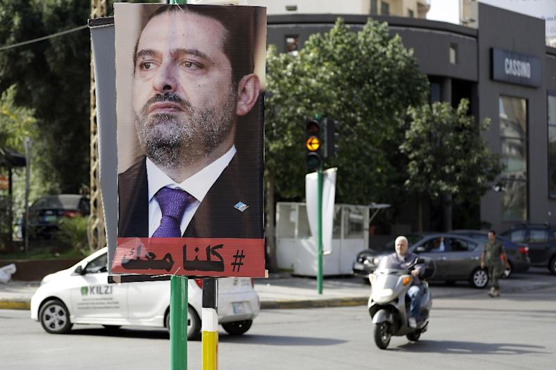 Lebanese Prime Minister Saad Hariri, whose image is on a poster here, issued a statement on television there on November 4 that he was stepping down because he feared for his life
