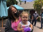 Lindsey Prescott looks at her 18-month-old daughter, Mia, as she giggles on Tuesday, May 11, 2021 in San Diego. Prescott moved into a converted San Diego hotel that Gov. Gavin Newsom visited Tuesday to announce a $12 billion program to get people like Prescott off the streets. (AP Photo/Julie Watson)
