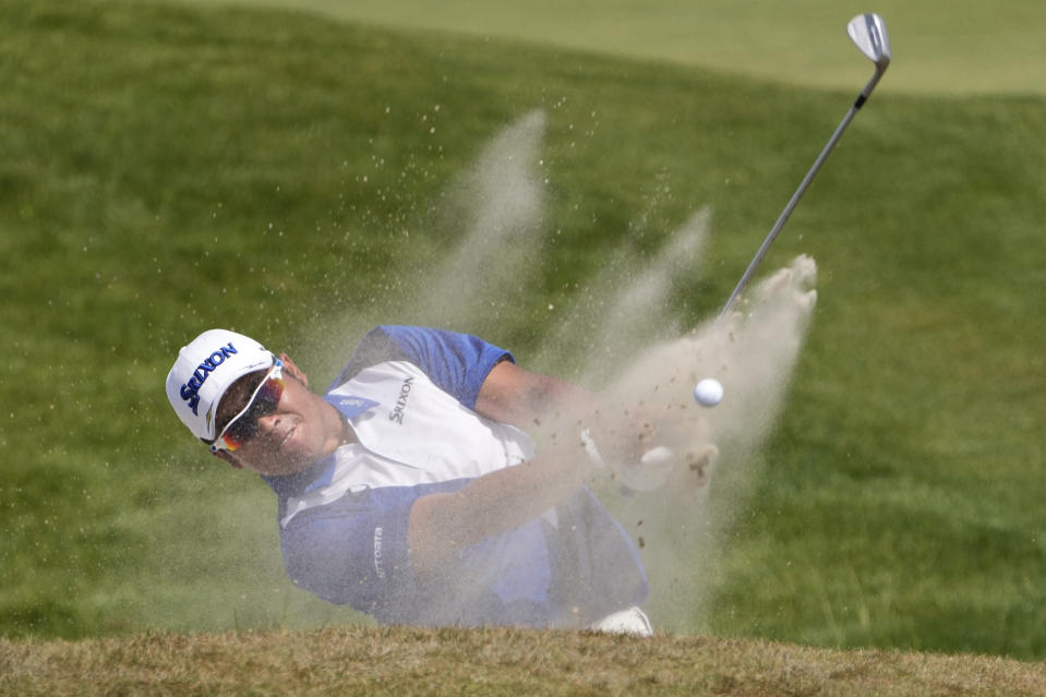 Hideki Matsuyama, of Japan, hits out of a bunker on the seventh hole during the third round at the PGA Championship golf tournament on the Ocean Course, Saturday, May 22, 2021, in Kiawah Island, S.C. (AP Photo/David J. Phillip)