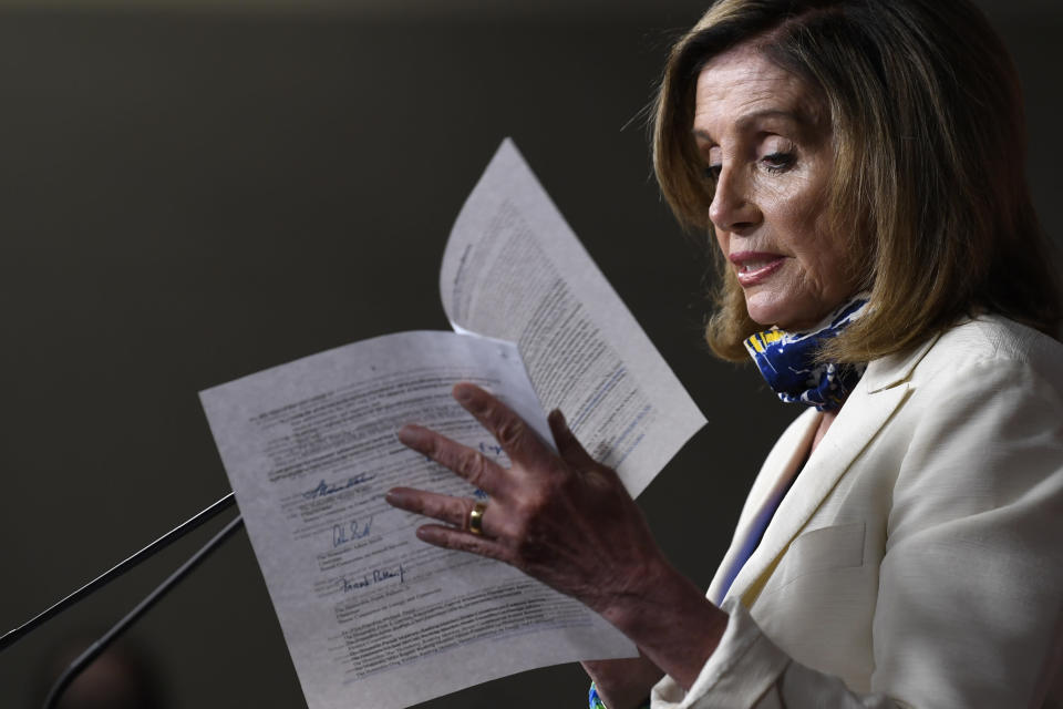 """FILE - In this July 16, 2020, file photo House Speaker Nancy Pelosi of Calif., speaks during a news conference on Capitol Hill in Washington. Pelosi said recently she finds herself yearning for an earlier era of Republicans in the White House, saying despite differences, even with Richard Nixon, who resigned facing impeachment, """"At least we had a shared commitment to the governance of our country."""" (AP Photo/Susan Walsh, File)"""