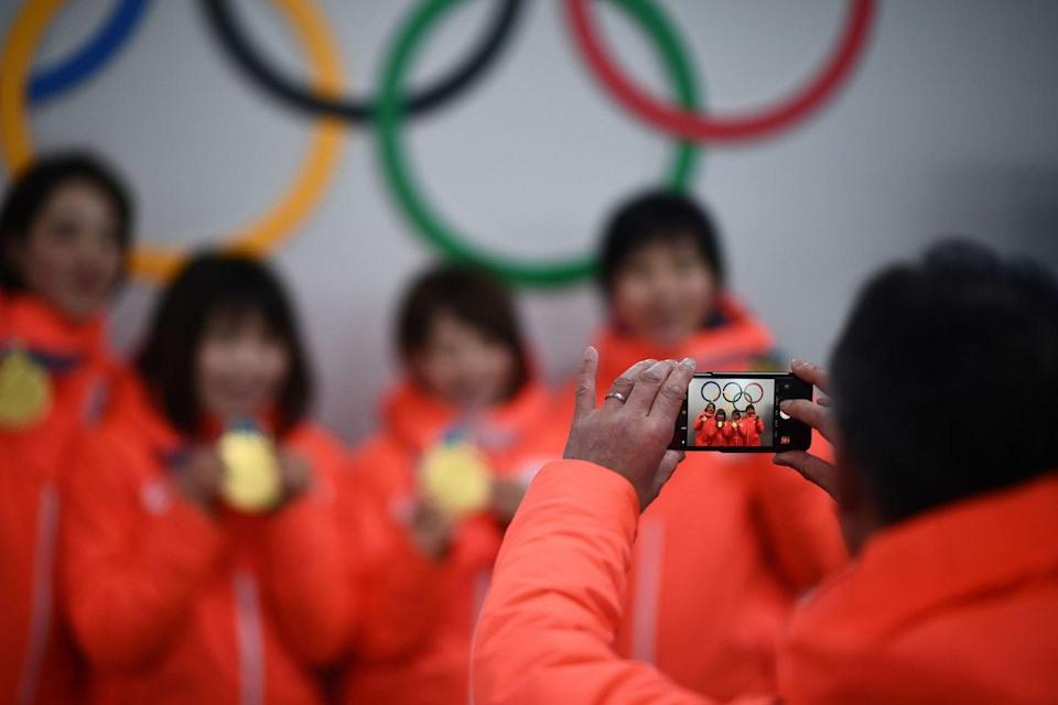 """<p>While athletes can use and post to <a href=""""https://stillmed.olympic.org/media/Document%20Library/OlympicOrg/Games/Winter-Games/Games-PyeongChang-2018-Winter-Olympic-Games/IOC-Social-and-Digital-Media-Guidelines/PyeongChang-2018-Social-Media-Guidelines-eng.pdf"""" rel=""""nofollow noopener"""" target=""""_blank"""" data-ylk=""""slk:social media"""" class=""""link rapid-noclick-resp"""">social media</a> during the games, there are restrictions. Images and video showing the field of play or backstage areas like athlete and coach only ares are off limits.</p>"""