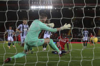 Liverpool's Sadio Mane scores the opening goal past West Bromwich Albion's goalkeeper Sam Johnstone during an English Premier League soccer match between Liverpool and West Bromwich Albion at the Anfield stadium in Liverpool, England, Sunday Dec. 27, 2020. (Nick Potts/Pool via AP)