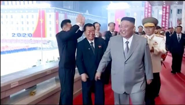 North Korean leader Kim Jong-un (centre) smiles as he leaves a ceremony to celebrate the 75th anniversary of the country's ruling party in Pyongyang. AP
