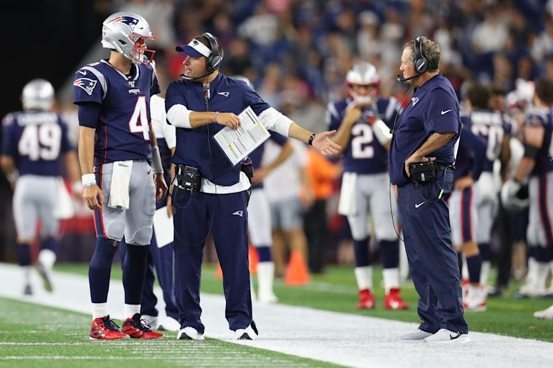 Jarrett Stidham of the New England Patriots talks with offensive coordinator Josh McDaniels and head coach Bill Belichick (right) during a preseason game last year. (Photo by Maddie Meyer/Getty Images)