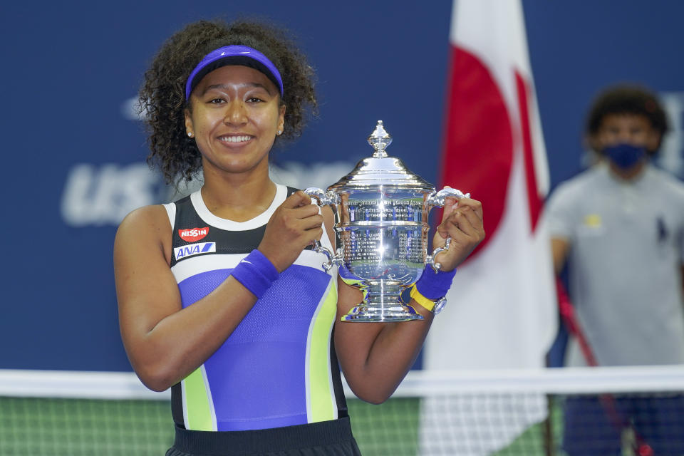 FILE PHOTO: Naomi Osaka, of Japan, holds up the championship trophy after defeating Victoria Azarenka, of Belarus, in the women's singles final of the US Open tennis championships, in New York on September 12, 2020. (AP Photo/Seth Wenig)