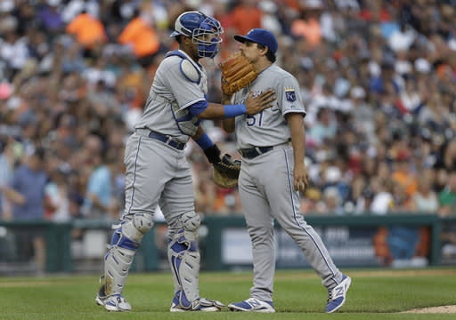 Kansas City Royals catcher Salvador Perez, left, talks with pitcher Jason Vargas against the Detroit Tigers in the third inning of a baseball game in Detroit, Monday, June 16, 2014. (AP Photo/Paul Sancya)