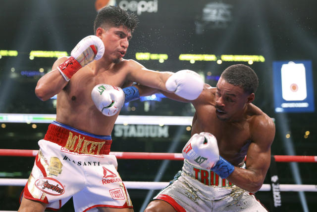 Mikey Garcia, left, tries to land a punch on Errol Spence Jr. during the sixth round of the IBF welterweight championship boxing bout Saturday, March 16, 2019, in Arlington, Texas. (AP Photo/Richard W. Rodriguez)