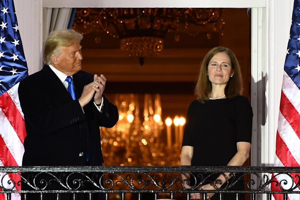 President Donald Trump applauds Amy Coney Barrett after she was sworn in as a Supreme Court Associate Justice during a ceremony on the South Lawn of the White House October 26, 2020, in Washington, D.C.