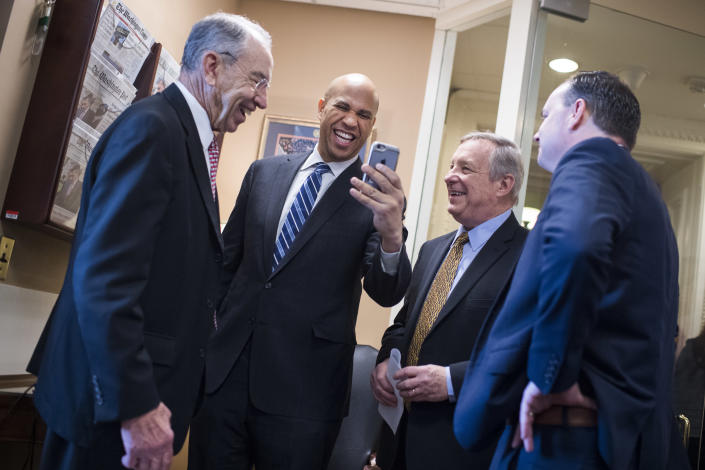 From left, Sens. Chuck Grassley, Cory Booker, Dick Durbin and Mike Lee after the passage of the First Step Act on Dec. 19. (Photo: Tom Williams/CQ Roll Call/Getty Images)