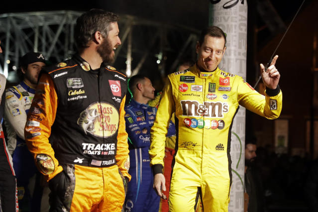 NASCAR driver Kyle Busch, right, is introduced before the Burnouts on Broadway competition Wednesday, Dec. 4, 2019, during NASCAR Champion's Week in Nashville, Tenn. (AP Photo/Mark Humphrey)