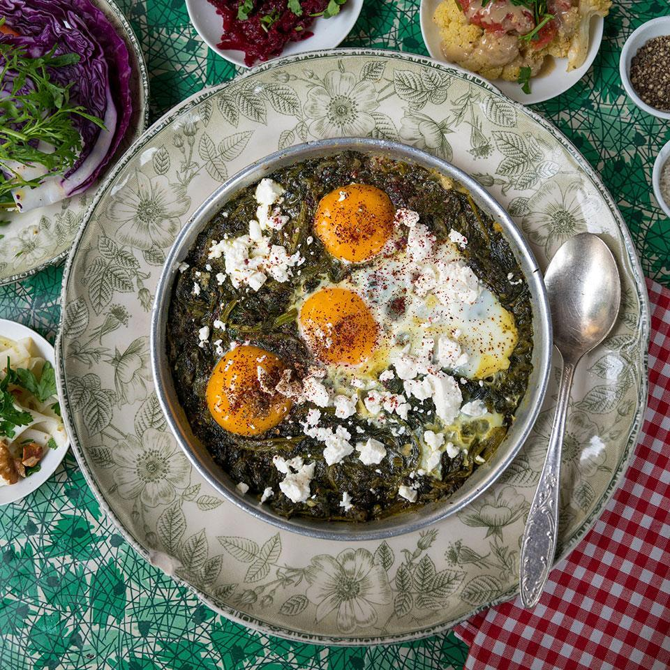 """<p>The inspiration for this green shakshuka recipe comes from HaBasta, a popular restaurant on the edge of Carmel Market in Tel Aviv, where the shakshuka is packed with green chard and spinach and a little hot pepper provides just a touch of spice. Serve with pita or crusty bread to sop up the sauce for a quick dinner or for brunch. <a href=""""http://www.eatingwell.com/recipe/272753/green-shakshuka-with-spinach-chard-feta/"""" rel=""""nofollow noopener"""" target=""""_blank"""" data-ylk=""""slk:View recipe"""" class=""""link rapid-noclick-resp""""> View recipe </a></p>"""