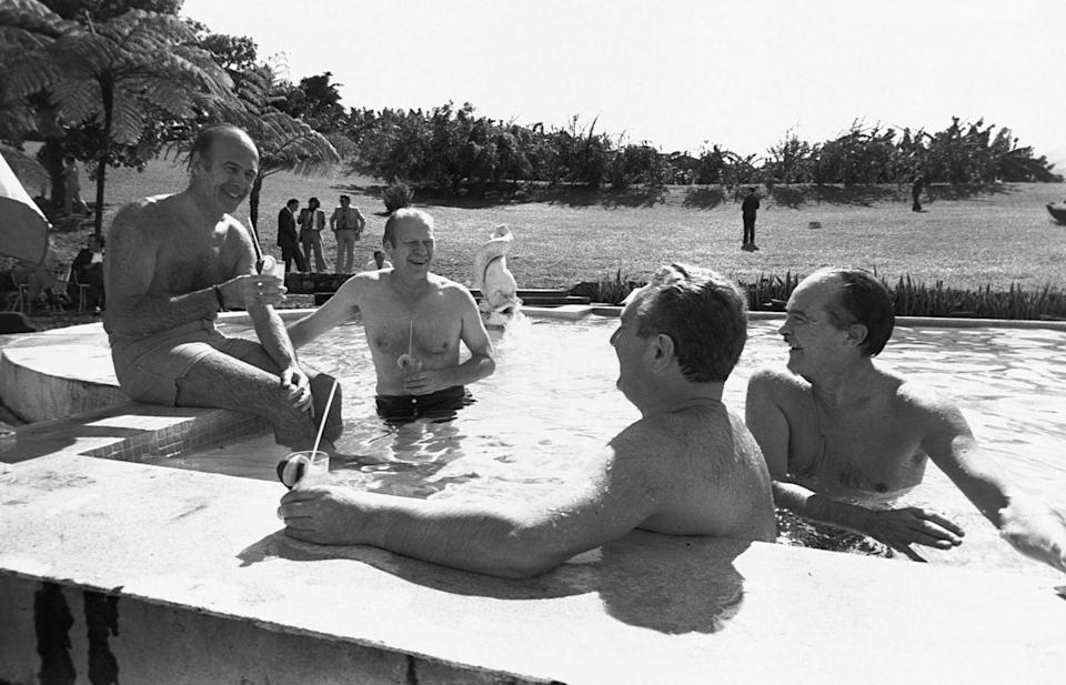 <p>Gerald Ford takes a dip with French president Valery Giscard D'Estaing during a working vacation on the island of Martinique in 1974. </p>