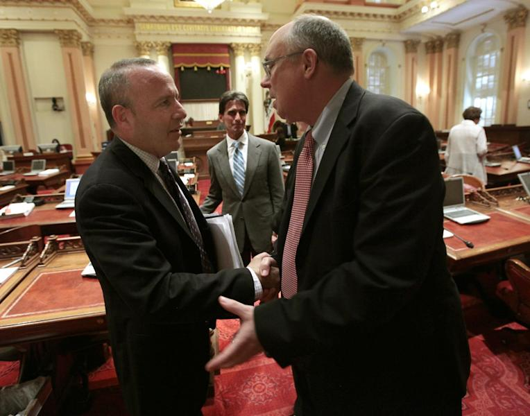 State Sen. Joe Simitian, D-Palo Alto, right, shakes hands with Senate President Pro Tem Darrell Steinberg, D-Sacramento after the bill authorizing about $4.5 billion funding for a high-speed rail system was approved by the Senate at the Capitol in Sacramento, Calif., Friday, July 6, 2012. The bill, which would allow the state to begin selling $2.6 billion in voter -approved bonds, was approved by a 21-16 vote and now goes to Gov. Jerry Brown who has supports the measure. Simitian was one of three Democrats who opposed the bill.(AP Photo/Rich Pedroncelli)