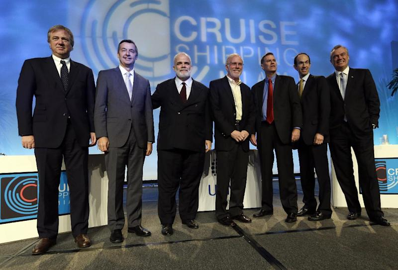 Panelists pose for a group photograph following the State of the Industry session at the 29th annual Cruise Shipping Miami conference, Tuesday, March 12, 2013, in Miami Beach, Fla. From left to right are Pierfrancesco Vago, CEO of MSC Cruises, Michael Bayley, president and CEO of Celebrity Cruises, Manfredi Lefebvre d'Ovidio, chairman of Silversea Cruises, Kevin Sheehan, CEO of Norwegian Cruise Line, Gerry Cahill, president and CEO of Carnival Cruise Lines, Adam Goldstein, president and CEO of Royal Caribbean International, and Stein Kruse, president and CEO of Holland America. (AP Photo/Lynne Sladky)