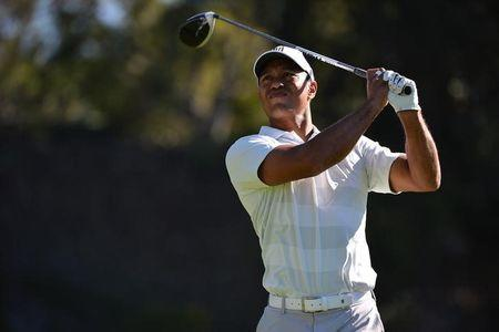 Feb 16, 2018; Pacific Palisades, CA, USA; Tiger Woods plays his shot from the ninth tee during the second round of the Genesis Open golf tournament at Riviera Country Club. Mandatory Credit: Orlando Ramirez-USA TODAY Sports