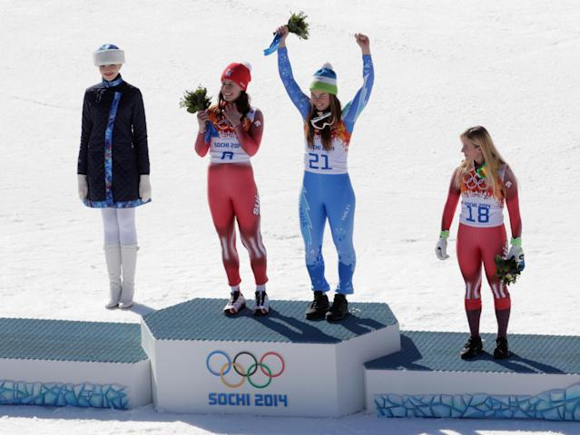 SOCHI, RUSSIA - FEBRUARY 12: (2nd L-R) Gold medalist Dominique Gisin of Switzerland, gold medalist Tina Maze of Slovenia and bronze medalist Lara Gut of Switzerland celebrate on the podium during the flower ceremony for during the Alpine Skiing Women's Downhill on day 5 of the Sochi 2014 Winter Olympics at Rosa Khutor Alpine Center on February 12, 2014 in Sochi, Russia. (Photo by Adam Pretty/Getty Images)