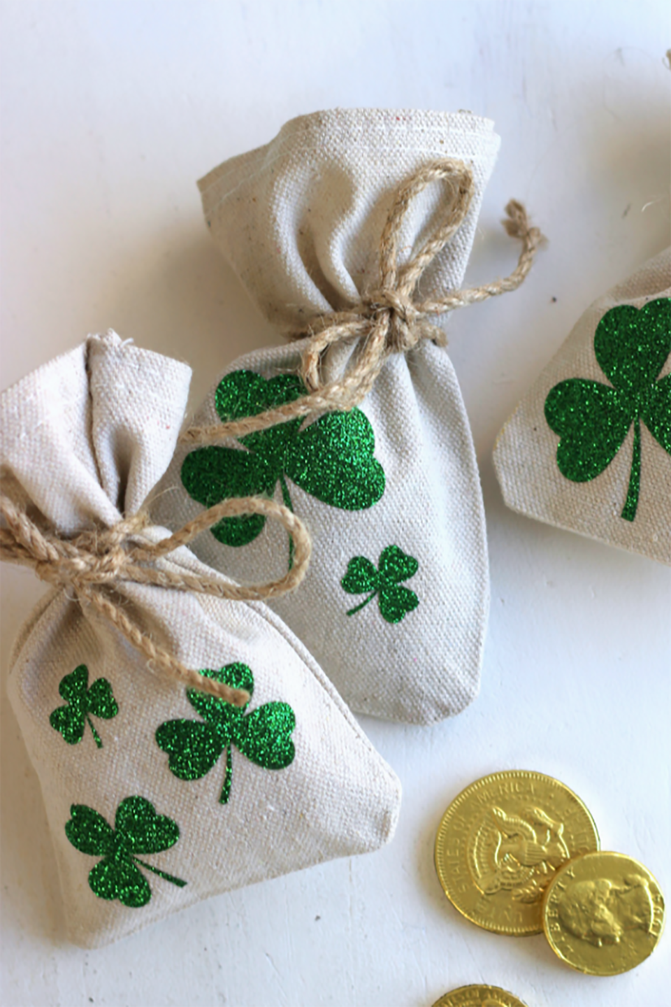 """<p>Surprise your kids or friends with some gold treats. It's their lucky day!</p><p><strong>Get the tutorial at <a href=""""http://www.ribbonsandglue.com/lucky-shamrock-coin-bags-diy.html#.WIeiy7YrJgc"""" rel=""""nofollow noopener"""" target=""""_blank"""" data-ylk=""""slk:Ribbons and Glue"""" class=""""link rapid-noclick-resp"""">Ribbons and Glue</a>. </strong></p>"""