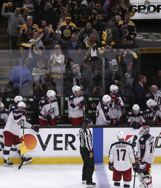 Columbus Blue Jackets players wait for the ruling on the Boston Bruins game-winning goal as fans celebrate during overtime of Game 1 of an NHL hockey second-round playoff series, Thursday, April 25, 2019, in Boston. The Bruins won 3-2. (AP Photo/Charles Krupa)