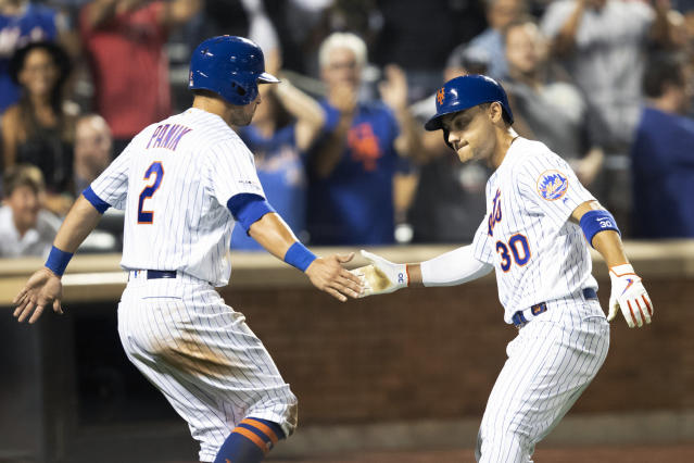 New York Mets' Michael Conforto (30) celebrates hitting a home run with Joe Panik (2) during the sixth inning of a baseball game against the Cleveland Indians, Tuesday, Aug. 20, 2019, in New York. (AP Photo/Mary Altaffer)