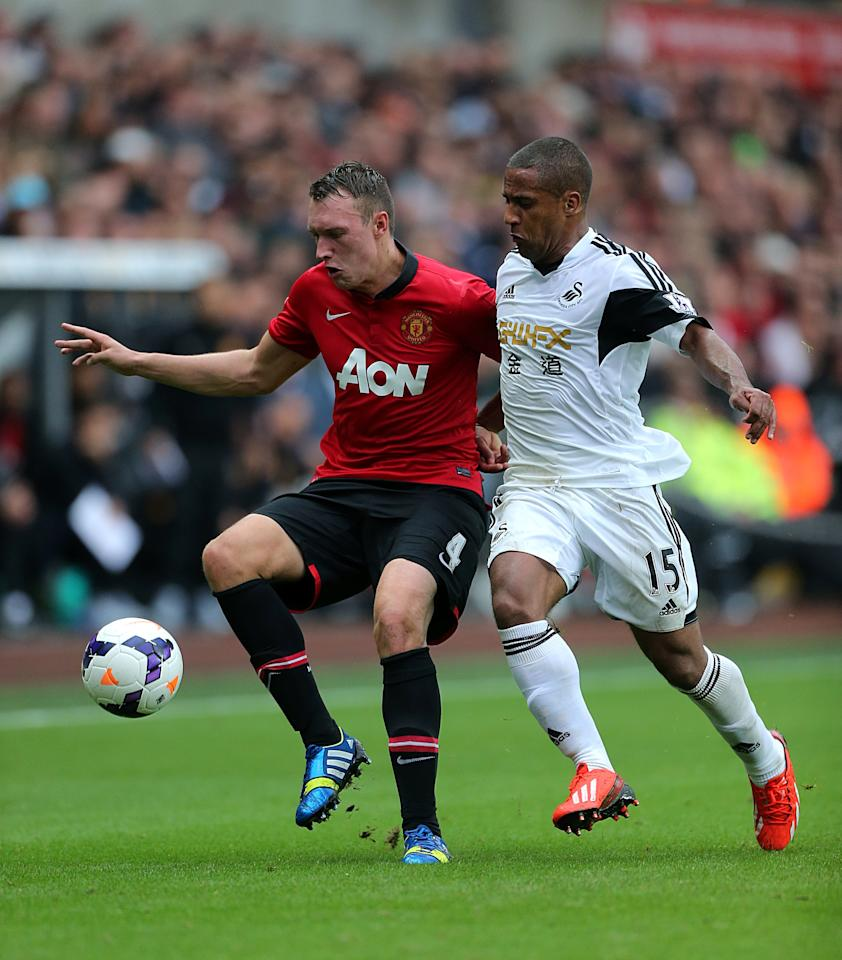 Manchester United's Phil Jones (left) and Swansea City's Ashley Williams battle for the ball