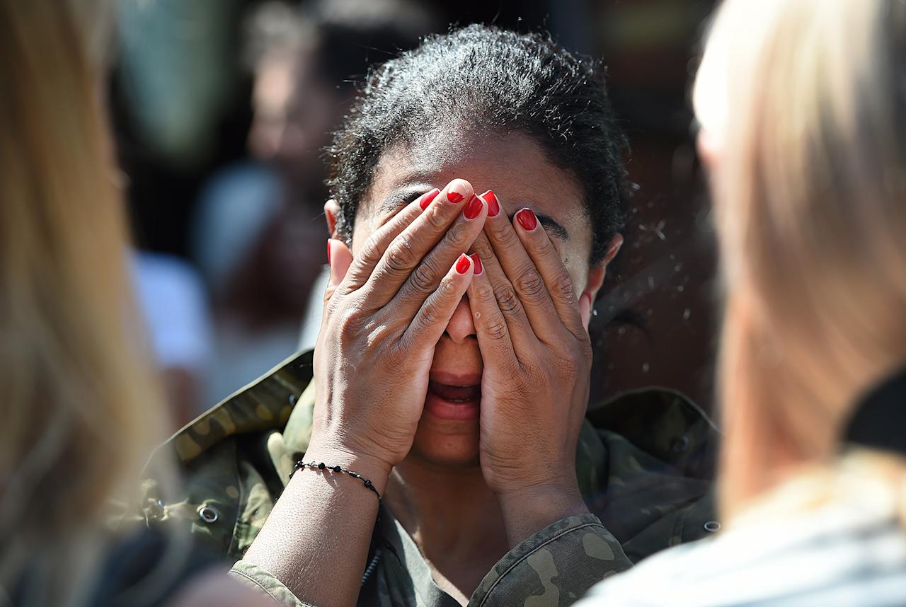 <p>Local resident Amanda Fernandez reacts following a huge fire at the Grenfell Tower, a 24-storey apartment block in North Kensington, London, Britain, June 14, 2017. (Andy Rain/EPA) </p>