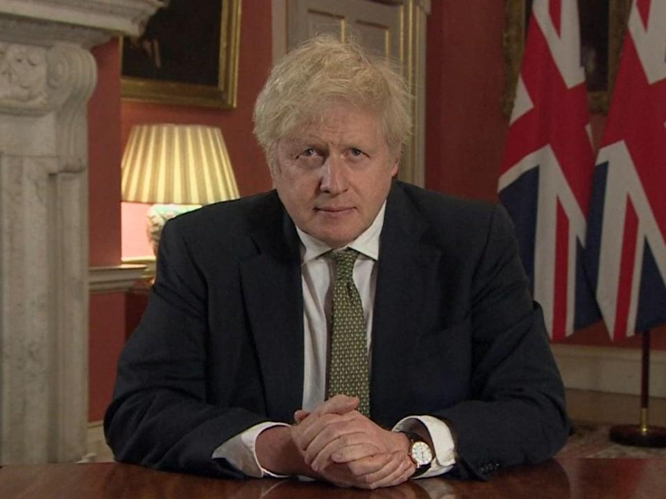 Boris Johnson making a televised address to the nation from 10 Downing Street setting out the terms of the latest coronavirus lockdown (PA)
