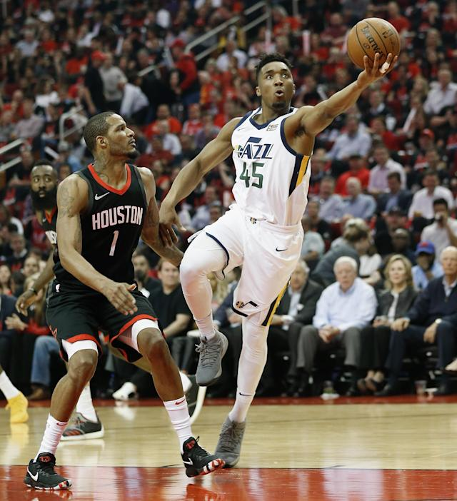 HOUSTON, TX - MAY 08: Donovan Mitchell #45 of the Utah Jazz drives around Trevor Ariza #1 of the Houston Rockets for a layup during Game Five of the Western Conference Semifinals of the 2018 NBA Playoffs at Toyota Center on May 8, 2018 in Houston, Texas. (Photo by Bob Levey/Getty Images)
