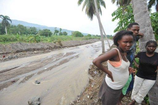 Haitians view damage done by torrential rains brought by Hurricane Sandy in the Nippes region of Haiti