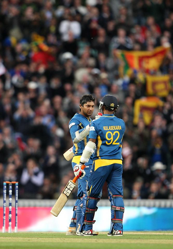 Sri Lanka's Kumar Sangakkara celebrates reaching a century of runs during the ICC Champions Trophy match at The Kia Oval, London.