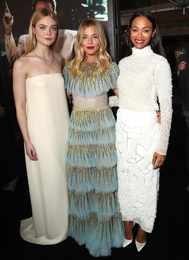<p><em><em><em>Live By Night</em> stars Elle Fanning, Sienna Miller and Saldana pose at the premiere on Jan. 9, 2017. (Photo: Todd Williamson/Getty Images) </em></em></p>