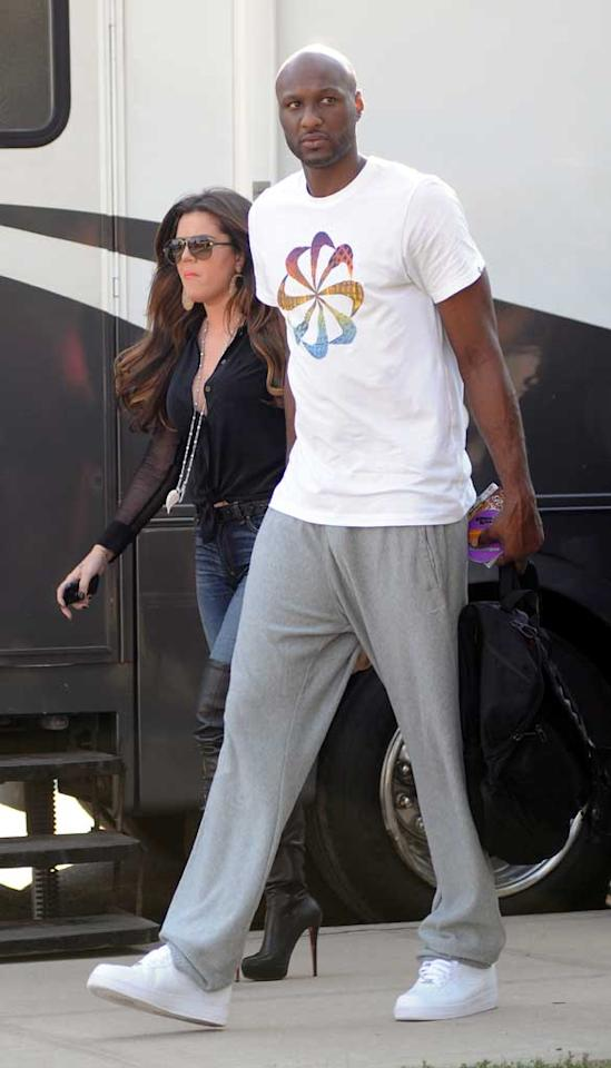 "Khloe Kardashian and her hubby, Lamar Odom, didn't crack a smile while on the set of a commercial in NYC the day after Odom was sitting in the backseat of a chauffeured car when it hit a motorcycle, which then struck a 15-year-old pedestrian. Sadly, the boy died of head injuries sustained during the accident. Elder Ordonez/<a href=""http://www.infdaily.com"" target=""new"">INFDaily.com</a> - July 15, 2011"