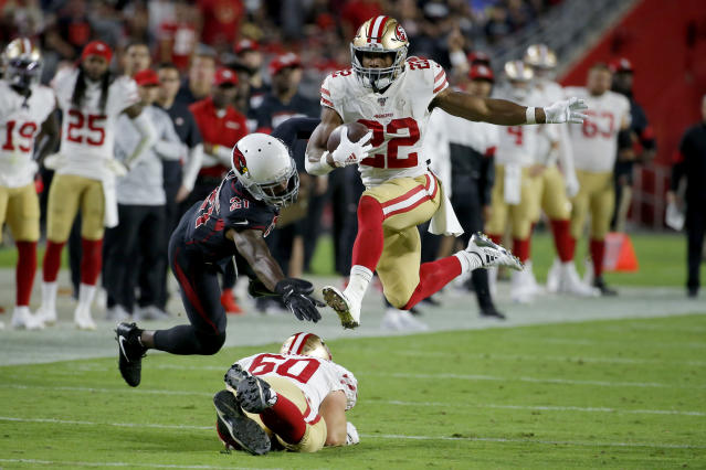 San Francisco 49ers running back Matt Breida (22) avoids the tackles of Arizona Cardinals cornerback Patrick Peterson (21) during the first half of an NFL football game, Thursday, Oct. 31, 2019, in Glendale, Ariz. (AP Photo/Rick Scuteri)