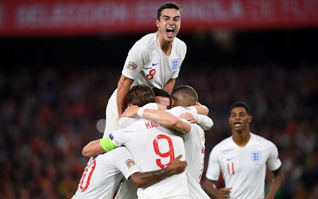 Harry Winks (top) celebrates after Raheem Sterling put England 3-0 up - Getty Images Europe