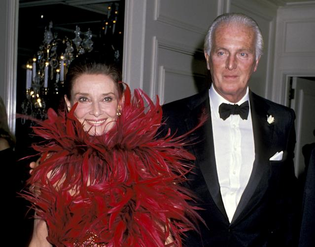 <p>Givenchy received a Lifetime Achievement Award from the State of California at the Beverly Wilshire Hotel in Beverly Hills in 1988, with Hepburn by his side. (Photo: Ron Galella/WireImage) </p>