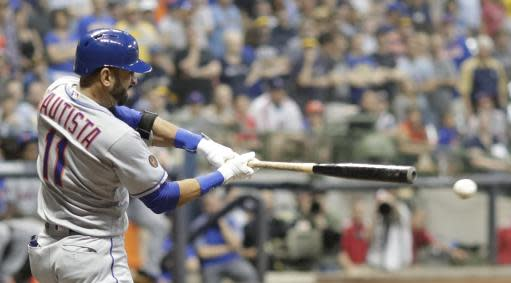 New York Mets' Jose Bautista hits an RBI single during the ninth inning of a baseball game against the Milwaukee Brewers Friday, May 25, 2018, in Milwaukee. (AP Photo/Morry Gash)