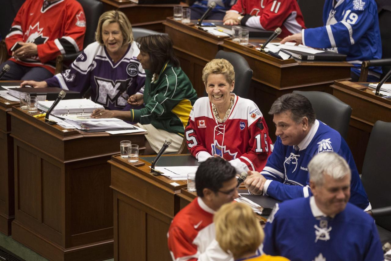 <p>Ontario Premier Kathleen Wynne joins other MPPs in wearing sports jerseys in tribute to the victims of the Humboldt Broncos bus crash, as they attend a session at the Queen's Park Legislature, in Toronto on Thursday, April 12, 2018.<br />(Photo by Chris Young, The Canadian Press) </p>
