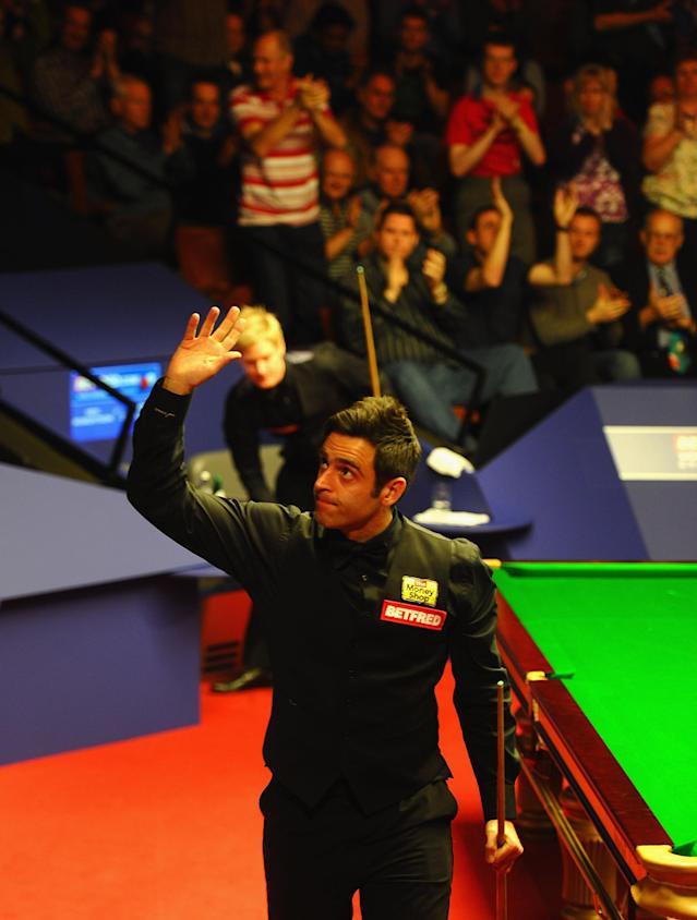 SHEFFIELD, ENGLAND - MAY 02: Ronnie O'Sullivan of England celebrates victory during his Betfred.com World Snooker Championship Quarter Final match against Neil Robertson of Australia at Crucible Theatre on May 2, 2012 in Sheffield, England. (Photo by Laurence Griffiths/Getty Images)