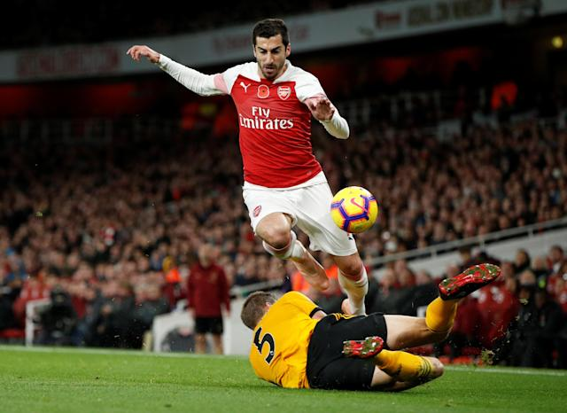 """Soccer Football - Premier League - Arsenal v Wolverhampton Wanderers - Emirates Stadium, London, Britain - November 11, 2018 Wolverhampton Wanderers' Ryan Bennett in action with Arsenal's Henrikh Mkhitaryan Action Images via Reuters/John Sibley EDITORIAL USE ONLY. No use with unauthorized audio, video, data, fixture lists, club/league logos or """"live"""" services. Online in-match use limited to 75 images, no video emulation. No use in betting, games or single club/league/player publications. Please contact your account representative for further details."""
